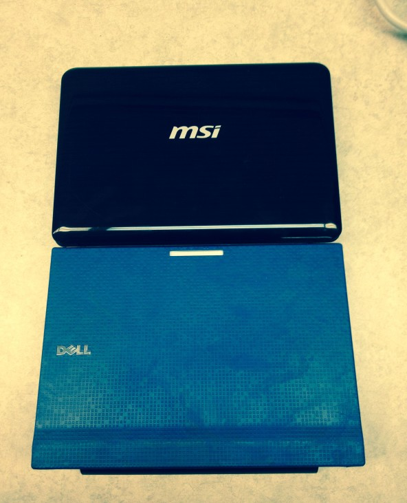a snappy picture of a shiny, dark colored MSI and a brilliant blue Latitude Chrome Kiosk